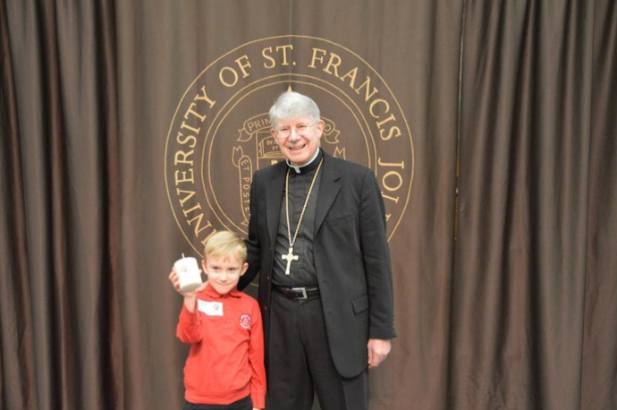 Noonan Elementary Student Attends Breakfast with the Bishop (Mokena Patch)